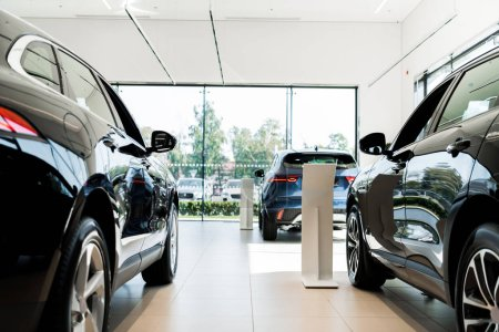 Photo for Selective focus of black luxury cars in car showroom - Royalty Free Image