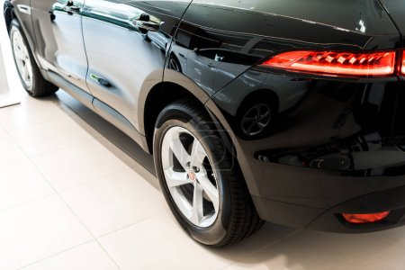 Photo for Black and luxury car in car showroom - Royalty Free Image