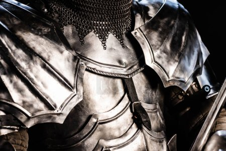 Photo for Cropped view of knight in armor isolated on black - Royalty Free Image