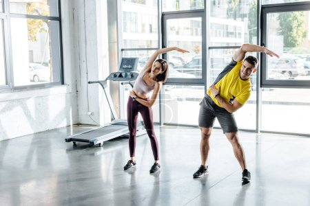 Photo for Sportsman and sportswoman working out together in sports center - Royalty Free Image