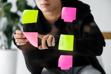 Photo for Cropped view of seo manager putting on glass colorful sticky note - Royalty Free Image
