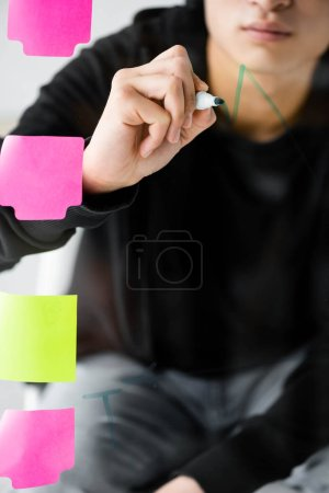 Photo for Cropped view of seo manager painting graphs on glass - Royalty Free Image