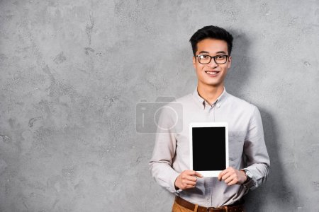 smiling asian seo manager holding digital tablet with copy space