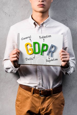 Photo for Cropped view of businessman holding paper with gdpr lettering - Royalty Free Image