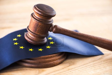 Photo for Gavel of judge with european union flag on wooden table - Royalty Free Image