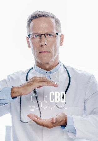 Photo pour Handsome doctor in white coat holding hands around cbd molecular structure illustration isolated on white - image libre de droit