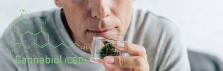 Photo for Cropped view of man in t-shirt holding medical cannabis in glass container, panoramic shot with cbd molecule illustration - Royalty Free Image