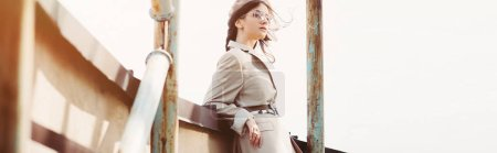 Photo for Fashionable elegant woman posing in beige suit and beret on roof - Royalty Free Image