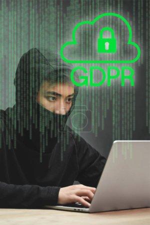 Photo pour Hacker asian using laptop and sitting near padlock illustration and gdpr lettering - image libre de droit