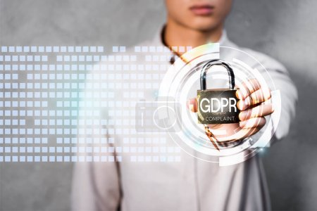 cropped view of businessman holding metal padlock with gdpr lettering and illustration