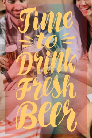Photo pour Partial view of multicultural friends clinking glasses of beer in pub with time to drink fresh beer illustration - image libre de droit