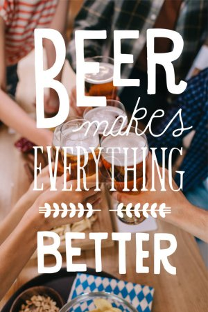 Foto de Cropped view of multicultural friends clinking glasses of light beer in pub with beer makes everything better illustration - Imagen libre de derechos