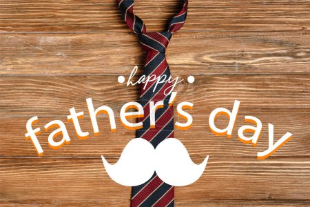Photo for Top view of mens striped fabric tie on wooden background, happy fathers day illustration - Royalty Free Image