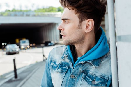 Photo for Selective focus of handsome man looking away near road at background - Royalty Free Image