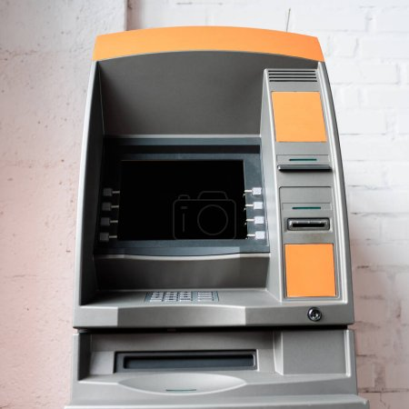 Photo for Atm with blank screen near white brick wall - Royalty Free Image
