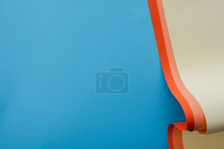 colorful paper swirl on blue background