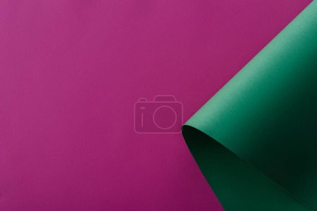 green paper swirl on purple background