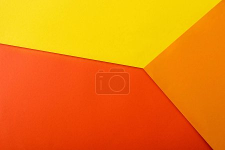 Photo for Abstract geometric background with red, yellow and orange bright paper - Royalty Free Image