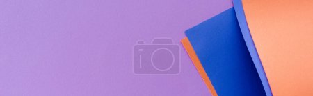 Photo for Blue and orange colorful paper swirl on lilac background, panoramic shot - Royalty Free Image