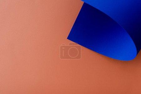 blue colorful paper on orange background