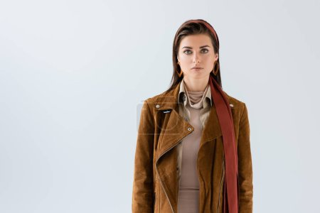 Photo for Front view of attractive woman in jacket looking at camera isolated on grey - Royalty Free Image