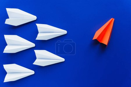 Photo for Top view of white and red paper planes on blue background, leadership concept - Royalty Free Image