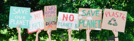 Photo for Panoramic shot of people holding placards with save our planet and one earth lettering outdoors, ecology concept - Royalty Free Image