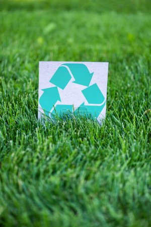Photo for Selective focus of card with recycle sign on green grass, ecology concept - Royalty Free Image