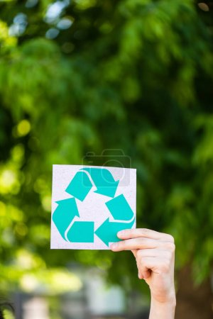Photo for Cropped view of man holding card with recycle sign outdoors, ecology concept - Royalty Free Image