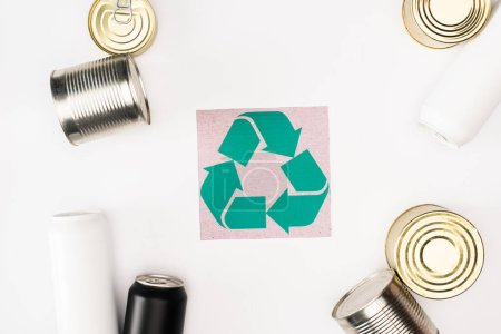 Photo for Top view of card with recycle sign near tin cans on white background, ecology concept - Royalty Free Image