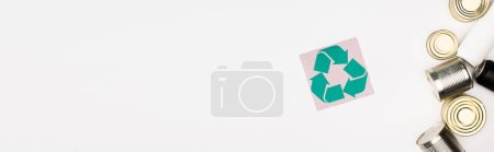 Photo for Horizontal crop of card with recycle sign and steel cans on white surface, ecology concept - Royalty Free Image