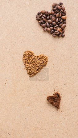 Photo for Top view of hearts made of coffee on beige surface - Royalty Free Image