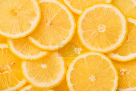 top view of sliced fresh and ripe yellow lemons