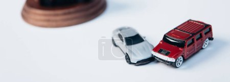Photo for Panoramic shot of toy cars on white, insurance concept - Royalty Free Image