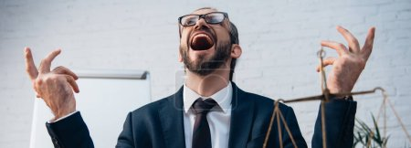 Photo for Horizontal image of excited and bearded lawyer with open mouth looking up in office - Royalty Free Image