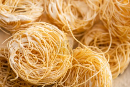 close up view of raw Italian Capellini with flour