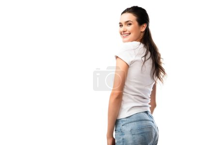 young brunette woman in white t-shirt and jeans looking at camera isolated on white