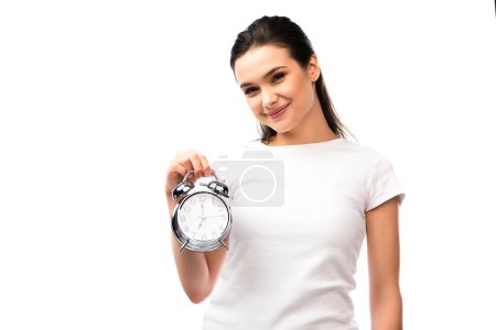 young woman in white t-shirt holding vintage alarm clock isolated on white