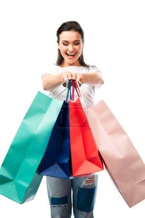 Photo pour Foyer sélectif de la femme tenant des sacs à provisions isolés sur blanc - image libre de droit