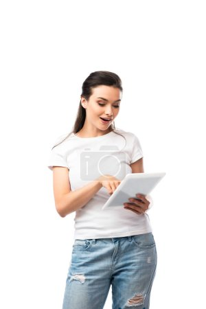 brunette woman in white t-shirt using digital tablet isolated on white