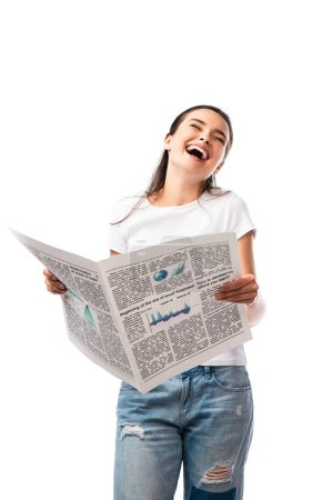 young woman in white t-shirt holding newspaper and laughing isolated on white