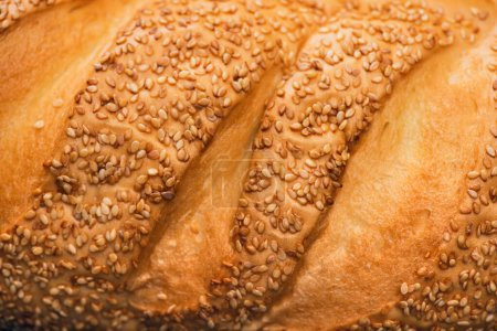 close up view of fresh baked bread crust with sesame