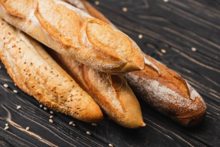 fresh baked baguette loaves on wooden surface