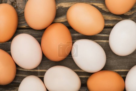 Photo for Top view of fresh chicken eggs on wooden surface - Royalty Free Image