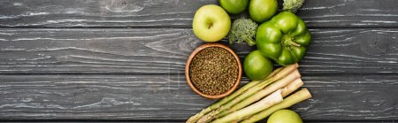 Photo for Top view of fresh green fruits and vegetables on wooden surface, panoramic shot - Royalty Free Image