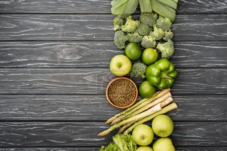 Photo for Top view of fresh green fruits and vegetables on wooden surface - Royalty Free Image