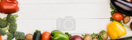 Photo for Top view of fresh ripe vegetables and fruits on wooden white background, panoramic shot - Royalty Free Image