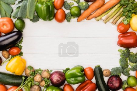 Photo for Top view of fresh ripe vegetables and fruits on wooden white background - Royalty Free Image