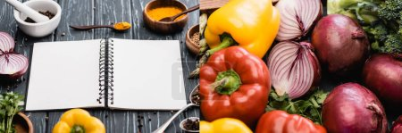 Photo for Collage of fresh colorful vegetables, spices and blank notebook on wooden surface - Royalty Free Image