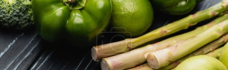 fresh green ripe fruits and vegetables on wooden surface, panoramic shot